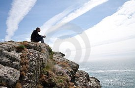 man-meditating-cliff-top-19809815